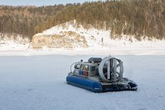 Hovercraft transporter on the ice of river in winter day Royalty Free Stock Photos
