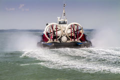 Hovercraft traveling away across sea Royalty Free Stock Images