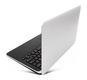 Hovering aluminium laptop, rear view,  on a white Royalty Free Stock Photos