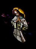 Hovering Angel. Antique stained glass of haloed angel hovering high above stock photo