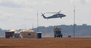 Hovering Blackhawk. GEORGETOWN, SC - March 9, 2015:  A U.S. Army National Guard Blackhawk helicopter hovers over a portable air traffic control installation Stock Photo