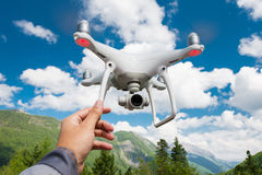 Hovering drone and a hand Royalty Free Stock Photo