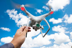 Hovering drone and a hand Royalty Free Stock Photos