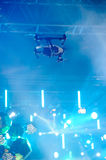 Hovering drone on stage Royalty Free Stock Photo