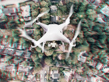 Hovering drone taking pictures of Dutch town. Aerial view. Stock Photos