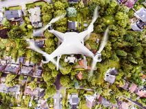 Hovering drone taking pictures of Dutch town. Aerial view. Royalty Free Stock Photo