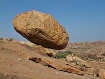 Hovering granite boulder in Hampi. Big balancing granite boulder in Hampi, India. Giving a impression of hovering above the ground stock photo