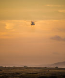 Hovering helicopter Stock Photo