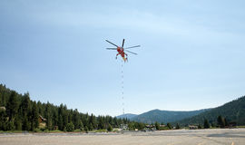 Hovering Industrial Helicopter or Sky Crane Stock Photography