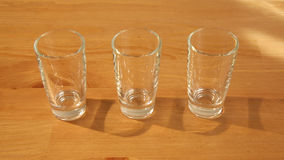 Hovering over 3 shot glasses stock footage