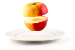 Hovering Sliced Apple Stock Images