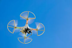 Hovering white drone with camera Royalty Free Stock Images
