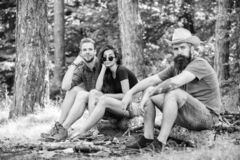 How build bonfire outdoors. Camping weekend leisure. Forest camping bonfire. Man brutal bearded hipster and friends. Relaxing forest. Ultimate guide to bonfires stock photos