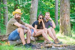 How build bonfire outdoors. Camping weekend leisure. Forest camping bonfire. Man brutal bearded hipster and friends. Relaxing forest. Ultimate guide to bonfires royalty free stock images