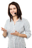 How can I assist you today?. Cheerful customer support executive at your service Stock Photography