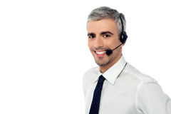 How can i help you?. Call center consultant with headset Royalty Free Stock Photography