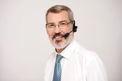 How can i help you?. Experienced call center executive wearing headset Royalty Free Stock Images