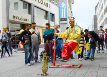 How?. COLOGNE, GERMANY 5TH JULY 2014 - An  unidentified street entertainer entertains the public on a busy shopping day in the town centre by appearing to be Royalty Free Stock Photos