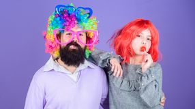 How crazy is your father. Man bearded father and girl wear colorful wig while eat lollipop candy. Thing loving father do. For children. Tribute to fun dad. Easy stock photography