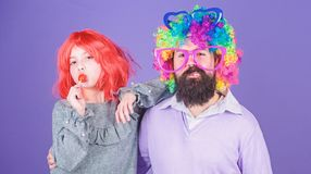 How crazy is your father. Man bearded father and girl wear colorful wig while eat lollipop candy. Thing loving father do royalty free stock photo