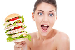 How delicious is that?. Young woman being surprised by the size of her sandwich Stock Images