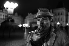 How do street artists make money on the old city square in Prague. stock image