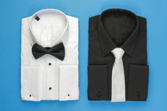 How do you choose to dress. White shirt with bow and black shirt with tie for man royalty free stock photos