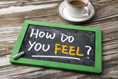 How do you feel?. How do you feel handwritten on blackboard stock photography