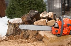 How do you like this chainsaw?. A chainsaw is a portable, mechanical saw which cuts with a set of teeth attached to a rotating chain that runs along a guide bar stock photos