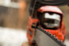 How do you like this chainsaw?. The top of the tip of the chainsaw guide bar is known as the KICKBACK DANGER ZONE stock image