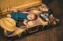 How does this thing turns on. Family. Child care. Small girl in suitcase. Traveling and adventure. Sweet little baby. New life and birth. Portrait of happy royalty free stock photo