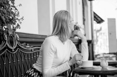 How enjoy being single tips. Woman lonely wait date. Dating advice for women. Still waiting him. Woman sits alone cafe. Terrace urban background defocused. Girl royalty free stock image