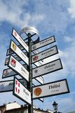 How far from Krakow. Sign pole in Krakow, Poland showing distance to various cities around the world Stock Photo