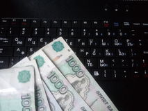 How fast money online. business. How fast to earn a day with the help of the internet, keyboard and real money Stock Photos