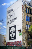 How long is now graffiti on a building wall in Berlin Royalty Free Stock Photo