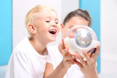 How is made eye?. Children watch a model eye in the laboratory school Royalty Free Stock Images