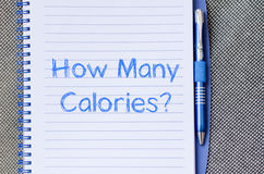How many calories write on notebook. How many calories text concept write on notebook Royalty Free Stock Photo