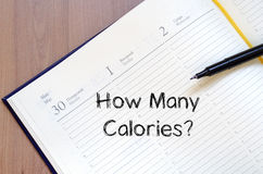 How many calories write on notebook Royalty Free Stock Photos