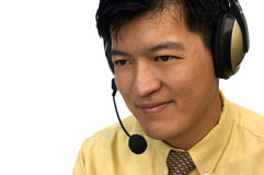 How May I Assist You?. Asian Male With Headset Listening To Customer stock image