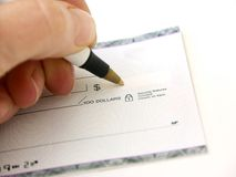 How much?. Hand writing a cheque,shallow dof Stock Images