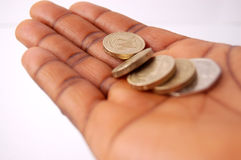 How much do I owe?. This is an image of a black hand, stretched out, assessing the amount of money possessed Stock Photos