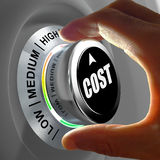 How much does it cost? Hand adjusting a Low to high cost button. Stock Photo