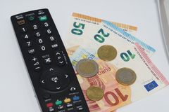 Pay TV. How much we have to pay to see our favorite Programm on TV Royalty Free Stock Photography
