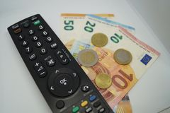 Pay TV. How much we have to pay to see our favorite Programm on TV Royalty Free Stock Photos