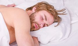 How much sleep you actually need. Man handsome guy lay in bed. Get adequate and consistent amount of sleep every night royalty free stock image