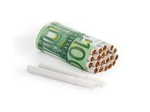 How much to smoke?. Cigarette in Euro tells about cost of smoking, isolated on white Royalty Free Stock Photography
