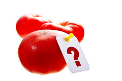 How much is the tomatoes. Fresh red tomatoes with a white question mark label stock image