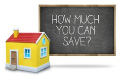 How much you can save on blackboard. How much you can save text on blackboard with 3d house front of blackboard on white background Royalty Free Stock Images