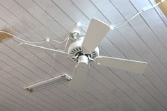 How not to install a ceiling fan. This picture shows a ceiling fan that was amateurishly do it yourself spliced into the electrical lighting system of a room Stock Photo