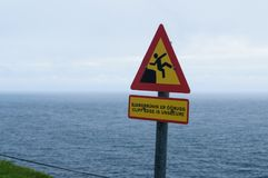 How painful is falling off a cliff. warning sign stock image